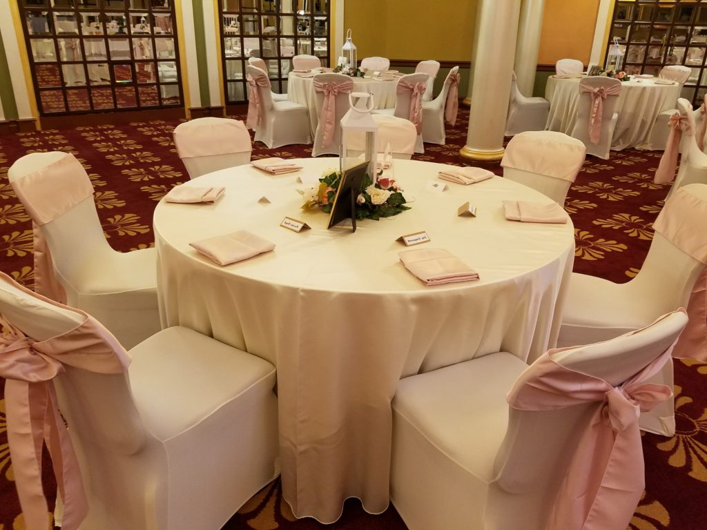 Blush Satin Sashes and Napkins with Ivory Majestic Tablecloths