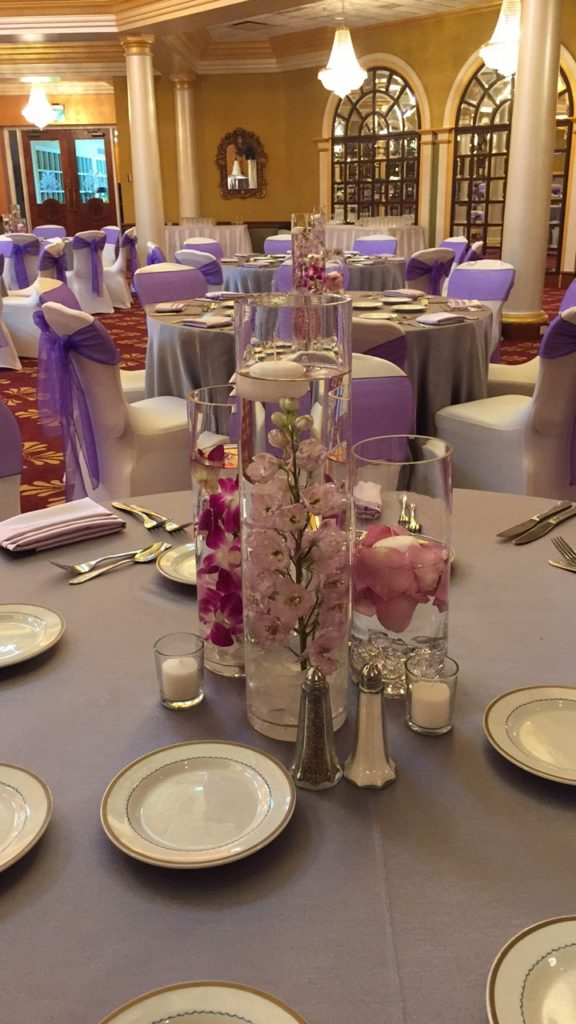 Purple Organza Sashes and Silver Tablecloths w/ Lilac Majestic Napkins