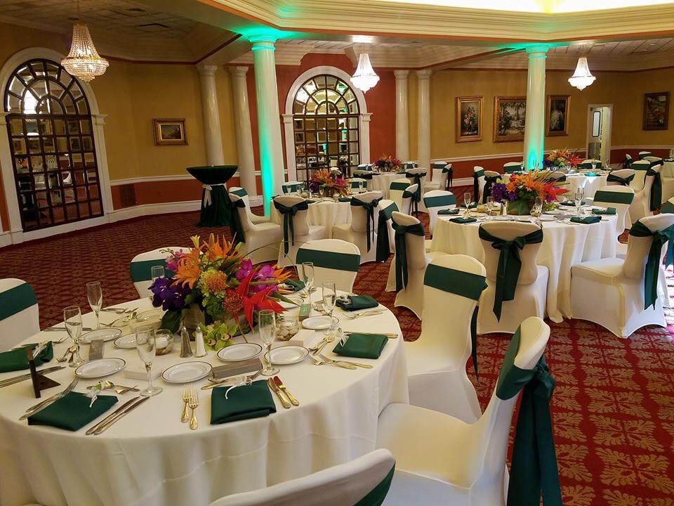 Hunter's Green Sashes and Napkins w/ Ivory Tablecloths