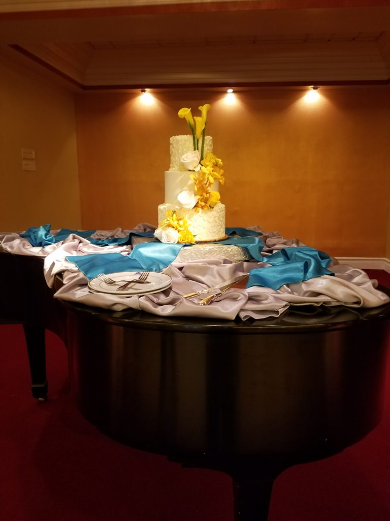 Silver Majestic Tablecloth and Turquoise Majestic Sashes Used For Fluff