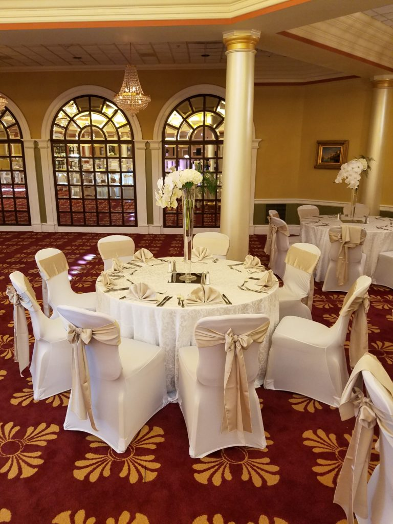 Champagne Majestic Sashes w Champagne Majestic Napkins and White Damask Tablecloths