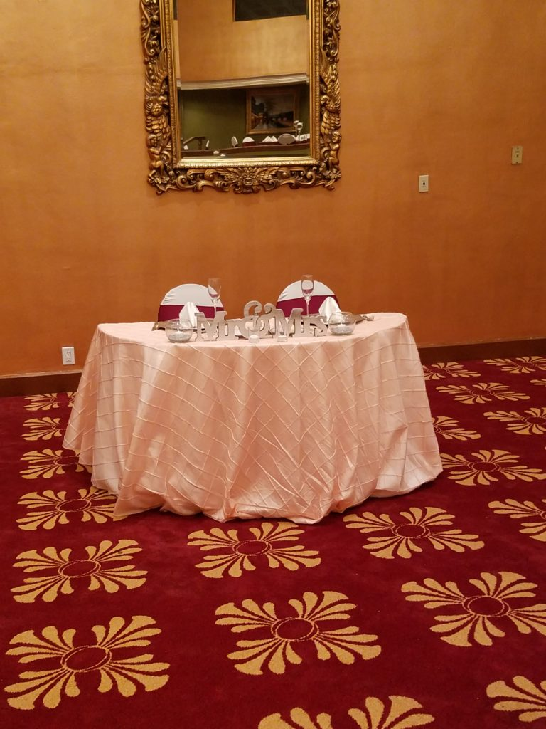 Blush Pintuck and Red Satin Sashes and White Napkins